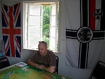 Kaiserschlacht 21 - Player Bryan Gagen considers his next manouvers during a Balloon busting mission, flanked by the Union Jack and the Imperial...